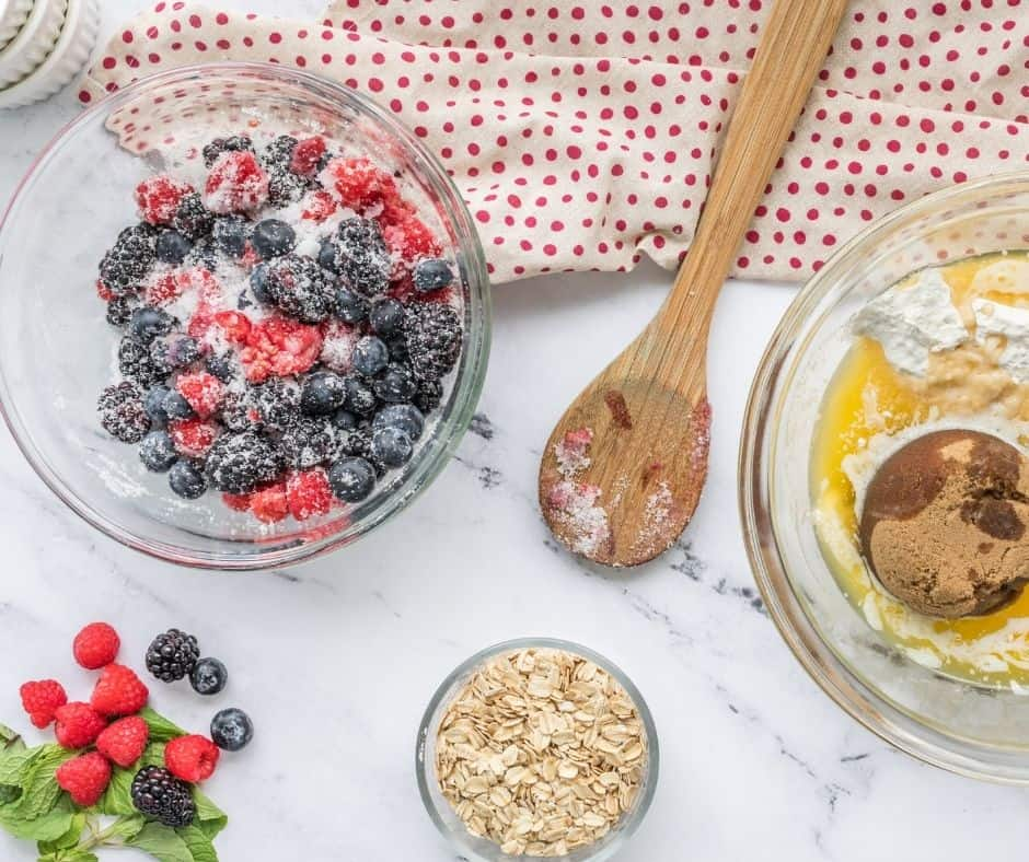 Preheat the air fryer to 400 degrees F, air fryer setting. Grease six 4-ounce ramekins, with either melted butter or cooking spray. Add all of the berries and granulated sugar to the mixing bowl and toss until coated.