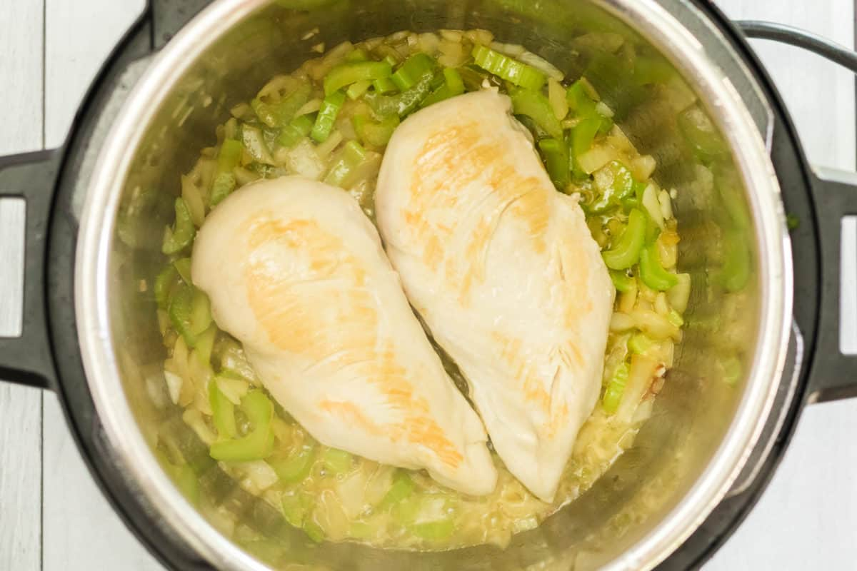 Chicken, Onions and Celery in Instant Pot Bowl Olive Garden Chicken and Gnocchi Soup