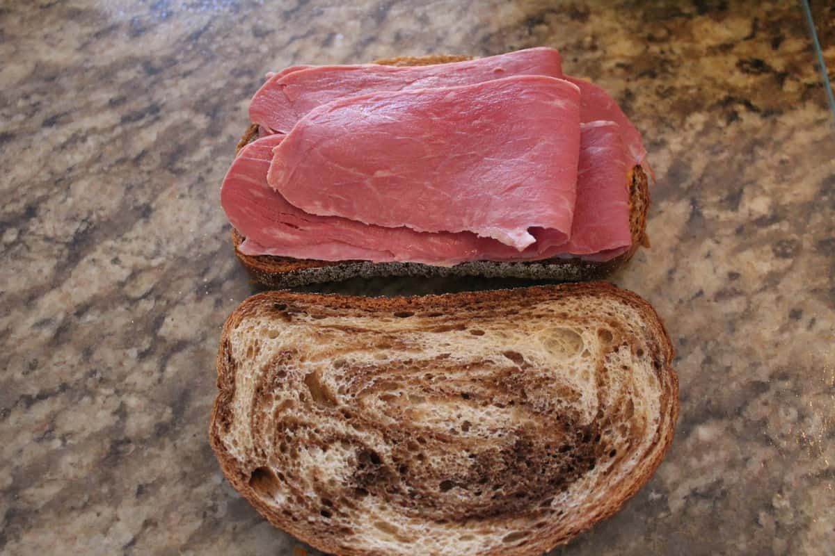 Making The Air Fryer Rueben Sandwich After you spread the Russian dressing on one side of the bread, add your sliced corned beef