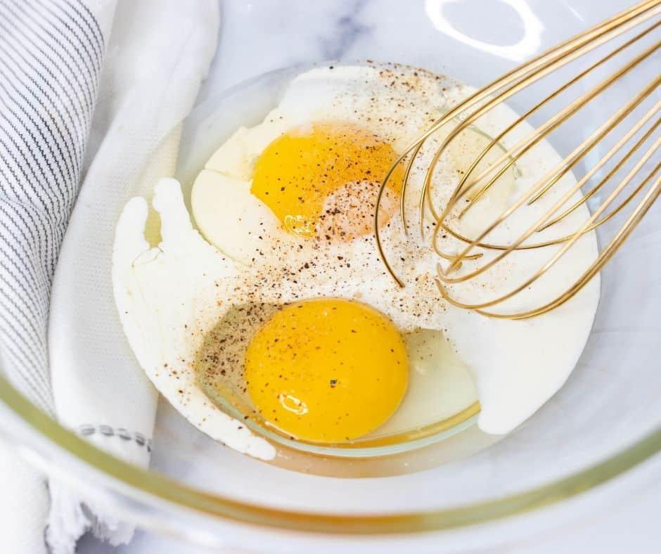 Air Fryer Cheese Omelet Whisking Eggs