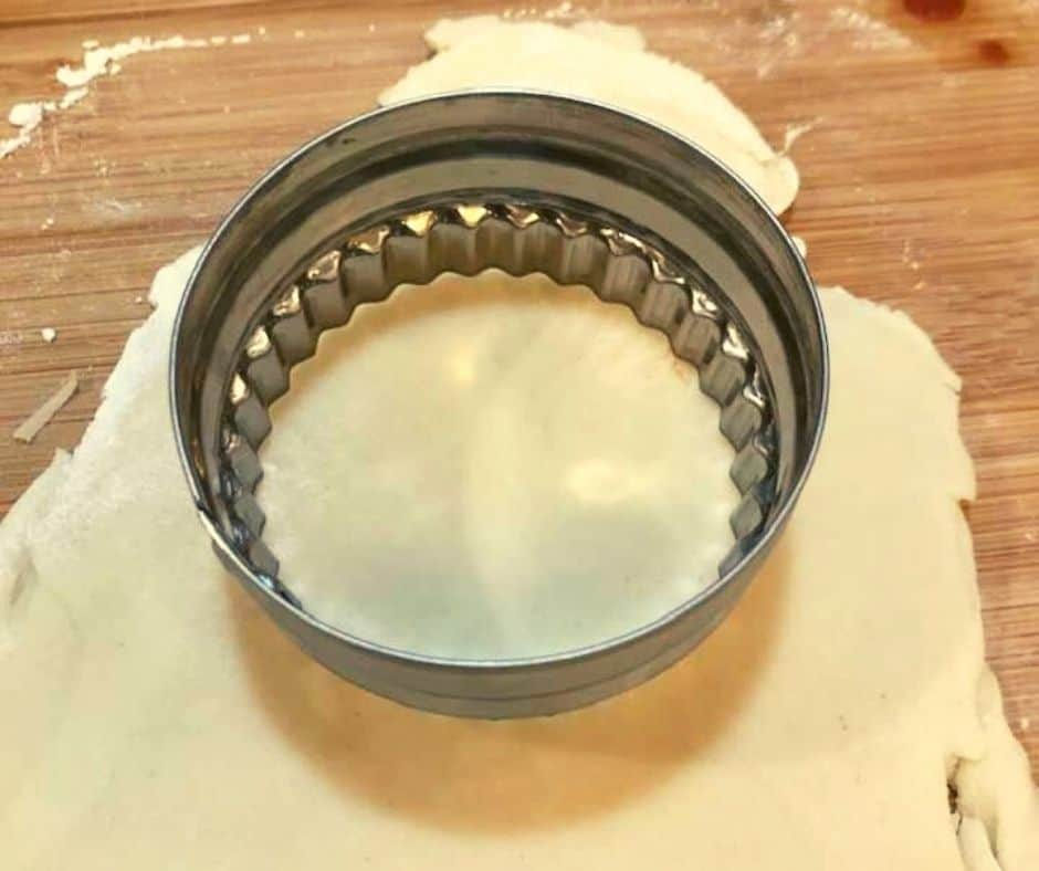 Cut out dough with biscuit cutter