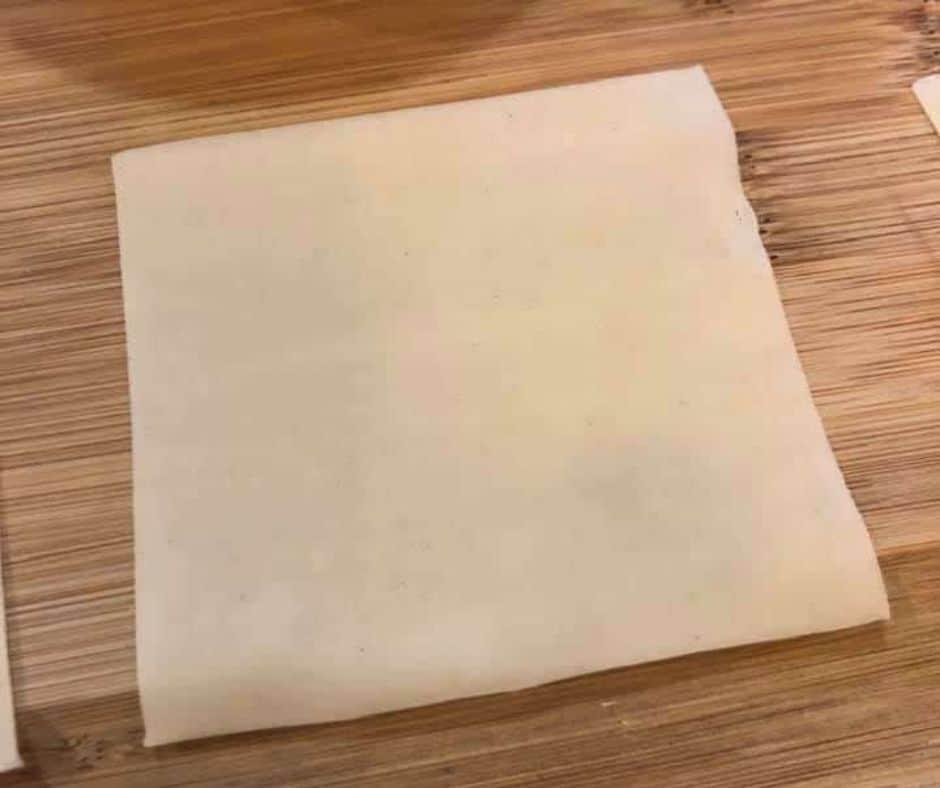 Wonton Wrappers on Cutting Board
