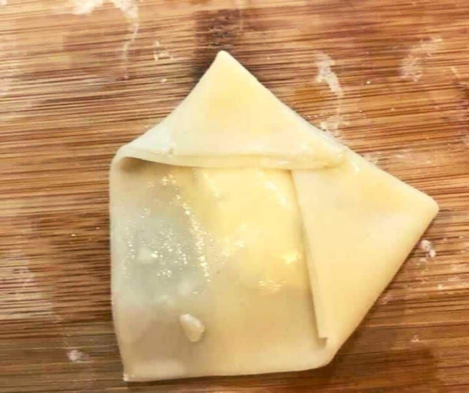 Fold your wonton wrapper up