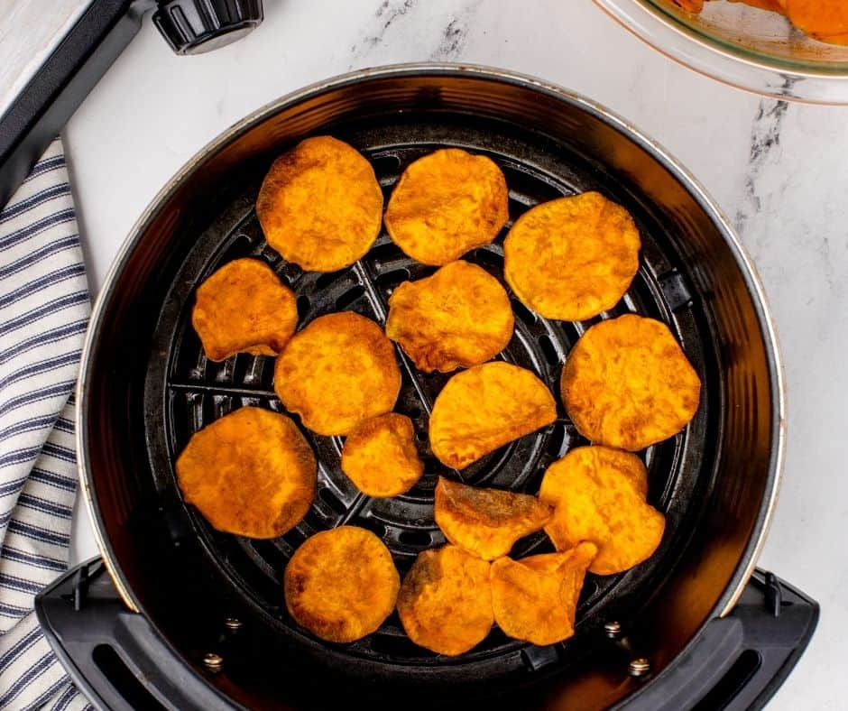 Cook the sweet potato chips for 5 minutes. Start checking at the 3-minute mark. Some of the chips will cook faster than others. Remove any chips that are brown around the edges. They will be pliable when you take them out of the basket but will start to crisp up as they cool