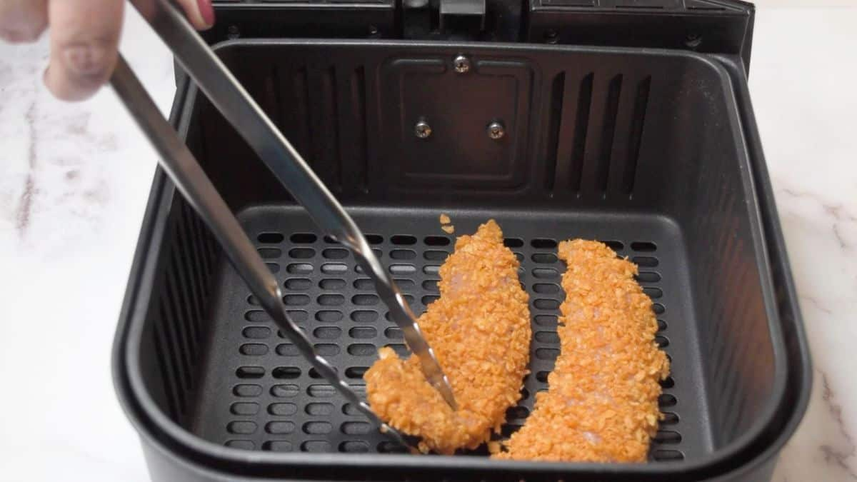 Place the coated chicken tenders on a greased air fryer tray or in the greased air fryer basket.