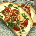 Air Fryer Ricotta Toast with Roasted Garlic and Tomatoes