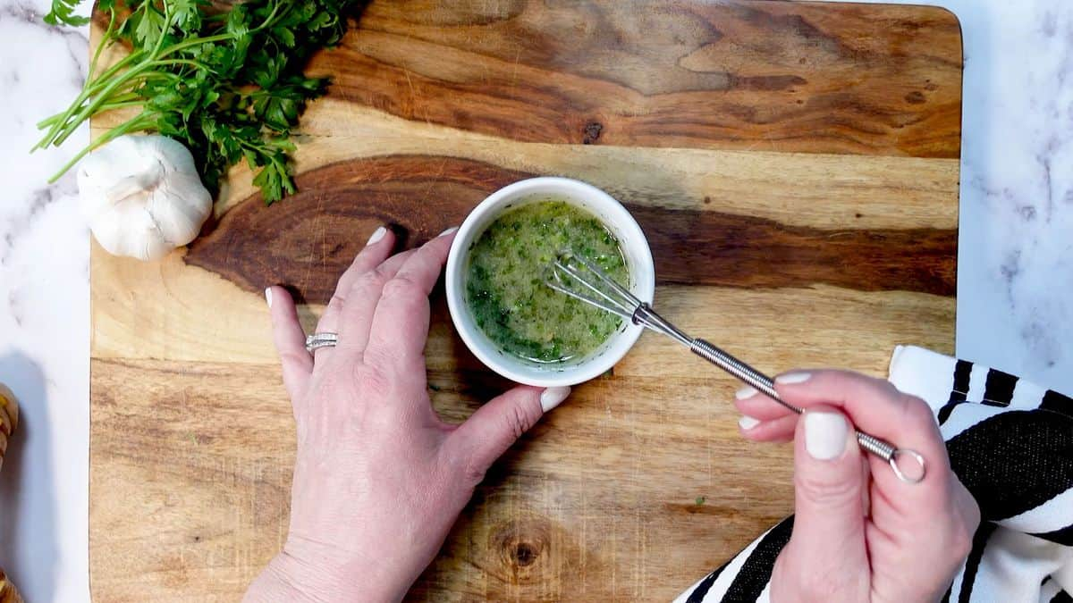Mix Herbs, Garlic and Butter in small bowl