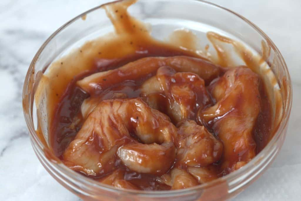 BBQ Chicken breast in a bowl marinating