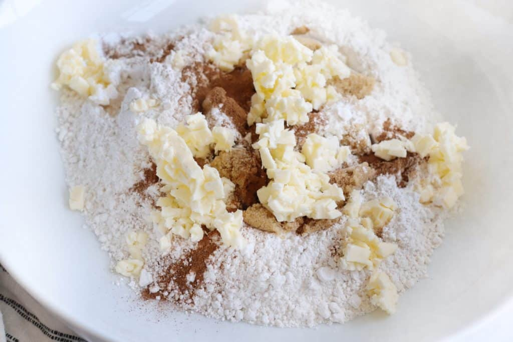 Bowl with ingredients and grated butter on top