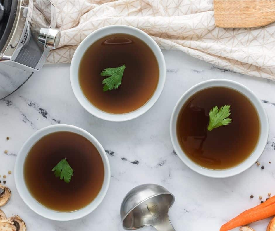 Instant Pot Vegetable Broth or Stock in Bowls On Table
