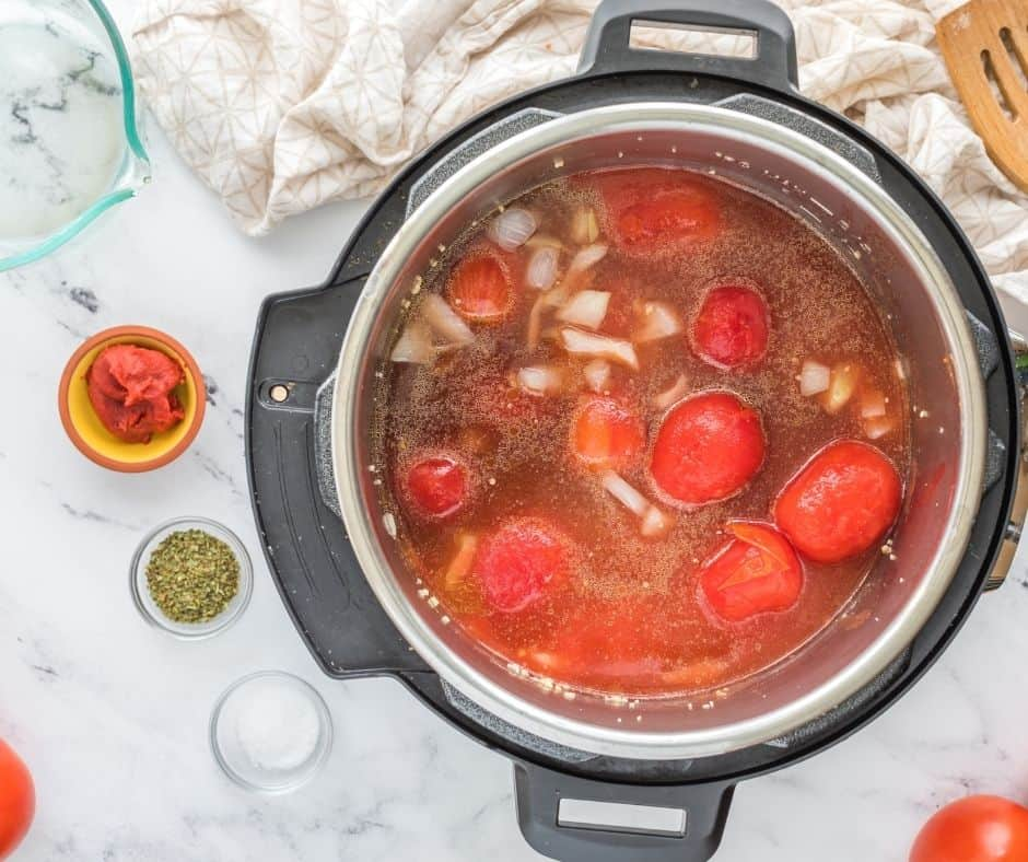 Add Tomatoes and Seasonings to Tomato Soup Instant Pot