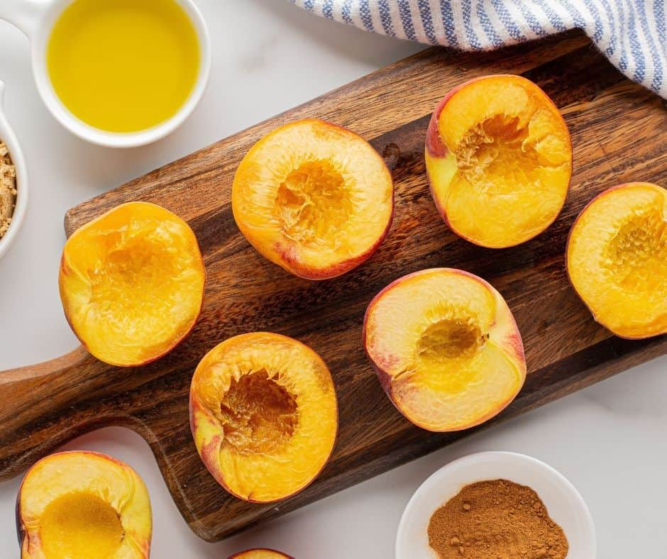 Pitted Peaches, Cut in Half on Cutting Board