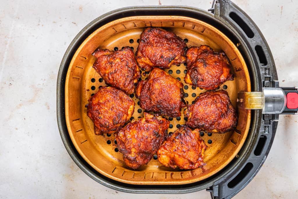 Air Fryer BBQ Chicken Thighs in Air Fryer Basket