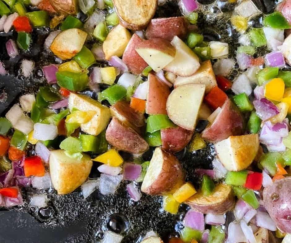 Saute Vegetables, Potatoes in Skillet
