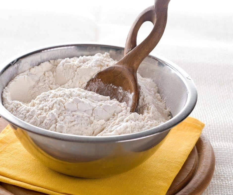 Flour, Sugar and Baking Powder in Metal Bowl