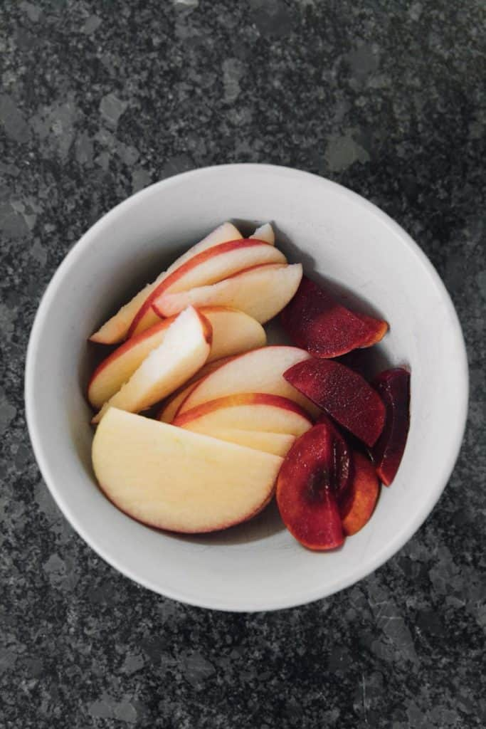 Sliced Apples and Plums in Bowl