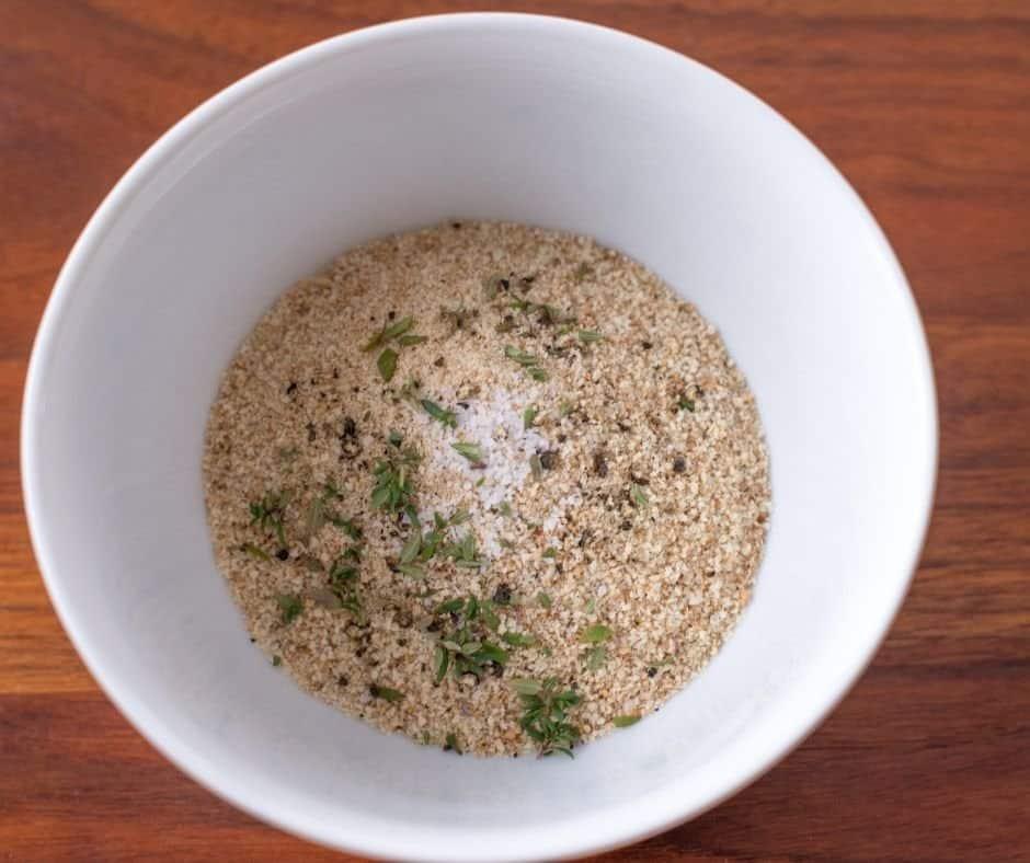 Breadcrumbs-in-bowl add seasonings