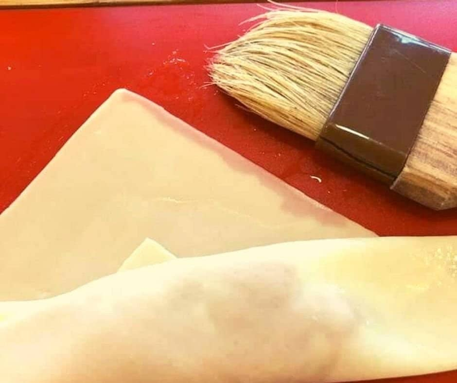 Brush Water on Egg Roll Wrappers